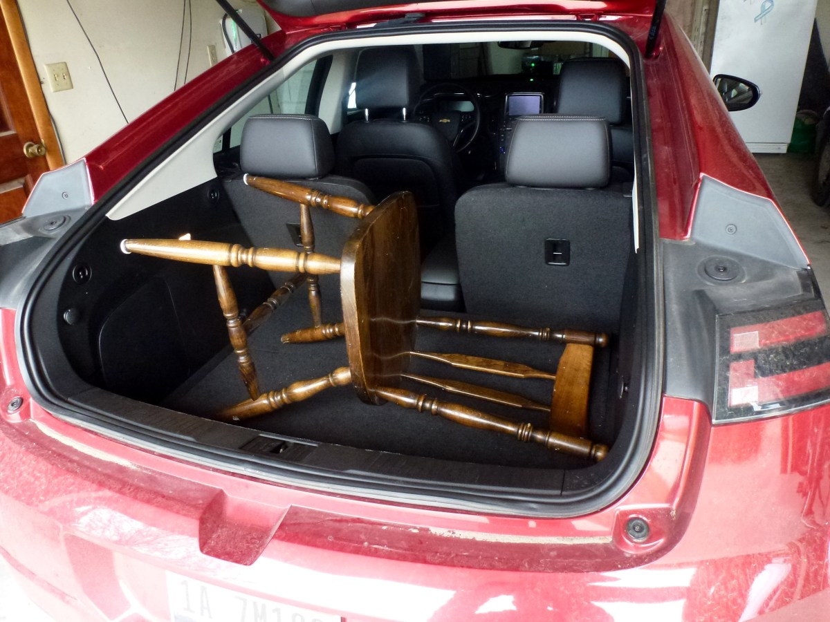 Hatchback storage in the Volt, with a kitchen chair in it for size comparison.