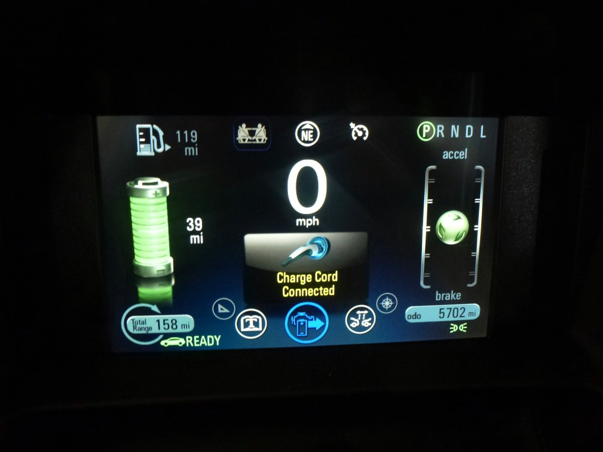 Showing that the charge cord is plugged in.  The car will not shift into gear.
