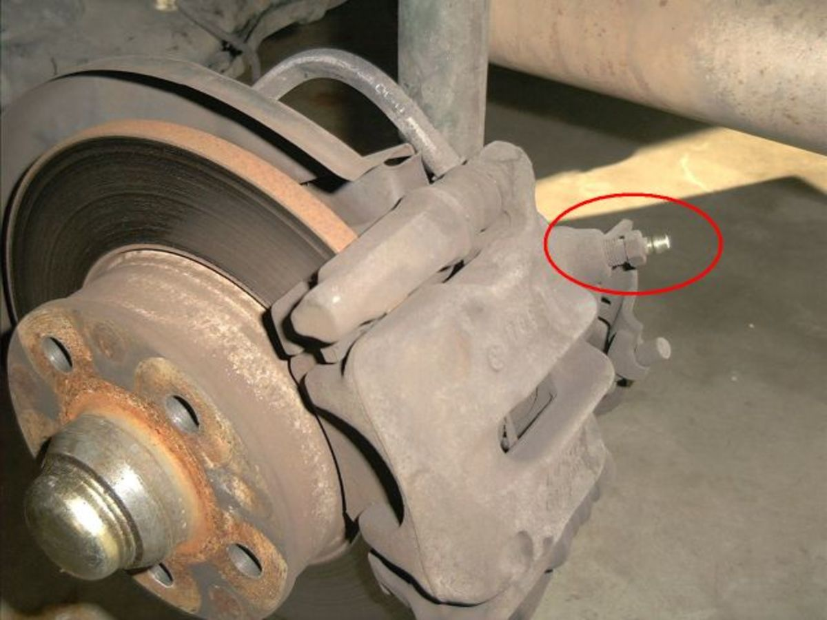 Locate the bleeder valve on your new brake caliper and wrap Teflon tape to the threads.