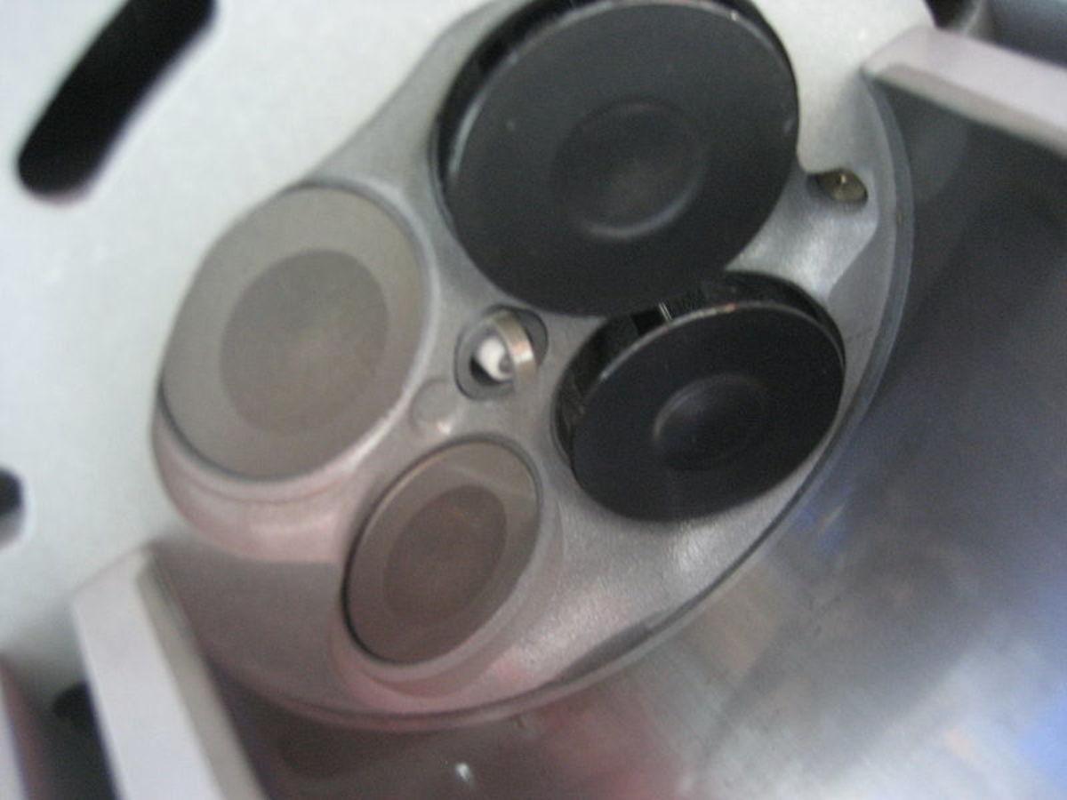 A sticking-open valve can cause a backfire.