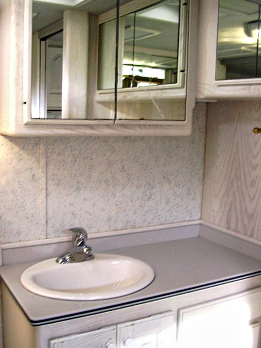 Some RVs like this Country Coach have bathroom sinks and counters that are ample.  Others, not so much.