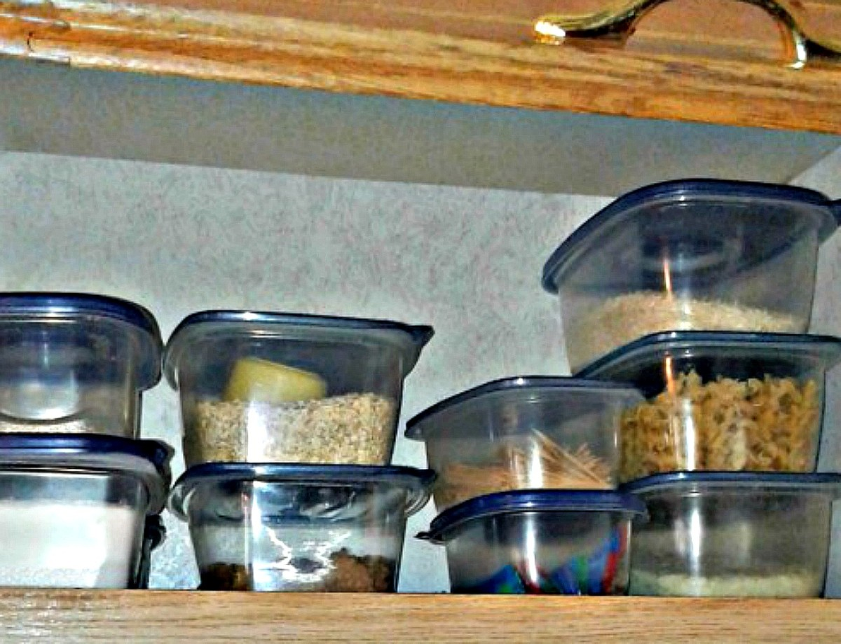 Lidded plastic containers save a huge amount of space in an RV cabinet.