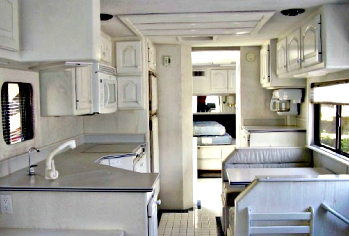 An example of a wide body RV that is decorated in light colors.