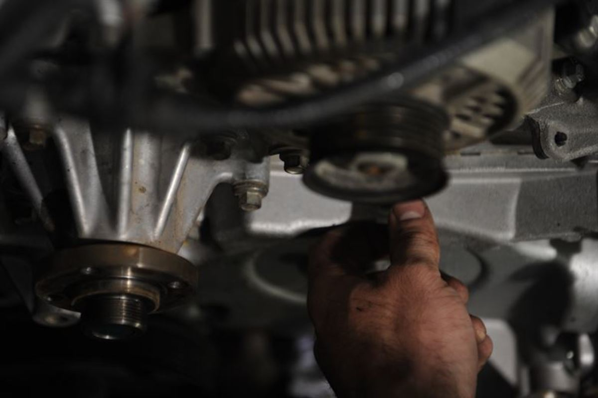 You may need to remove one or more accessories to detach the timing belt cover.