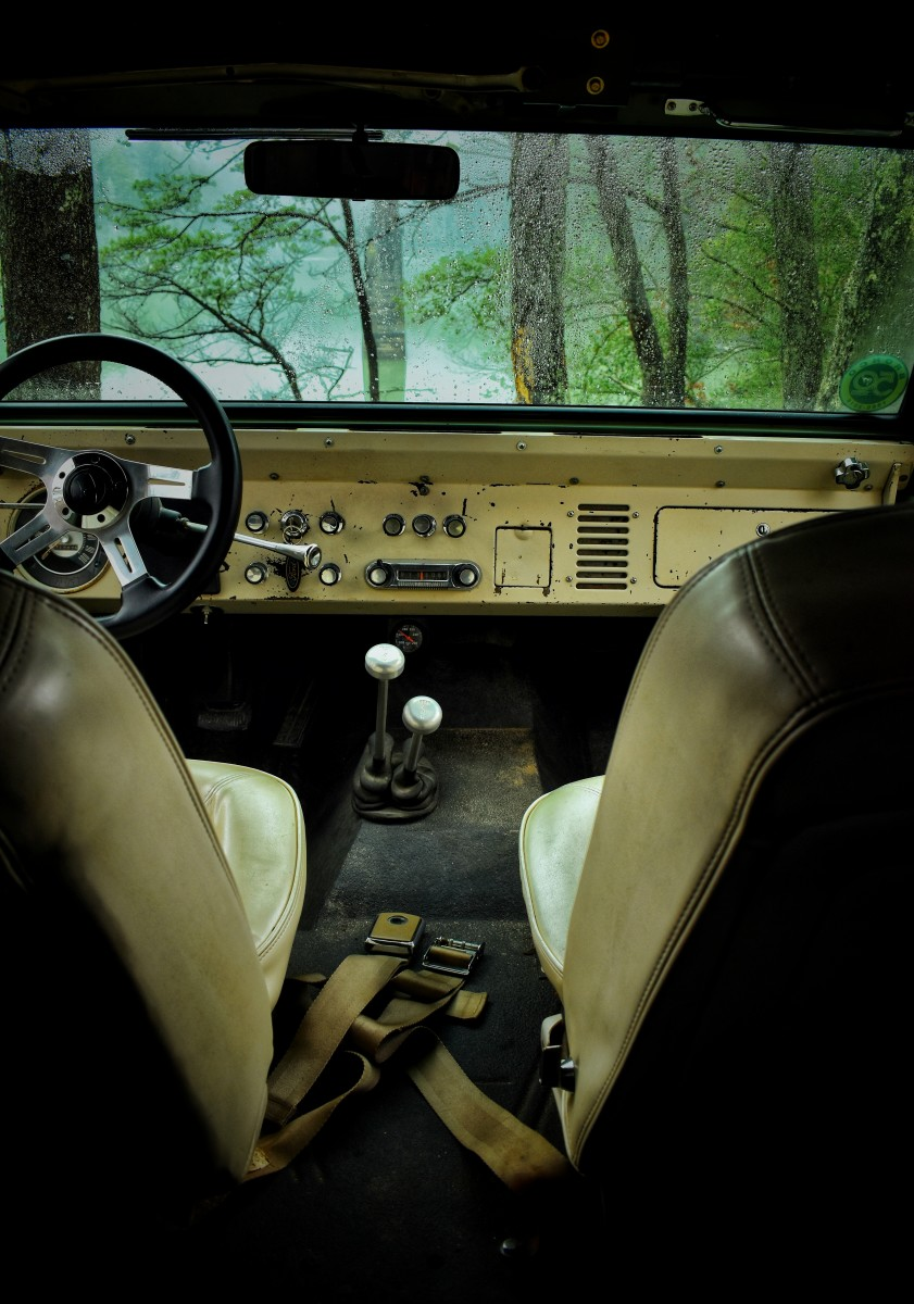 A sparse interior with only the addition of a twin-stick transfer case shifter and an aftermarket steering wheel soon-to-be replaced by an original.