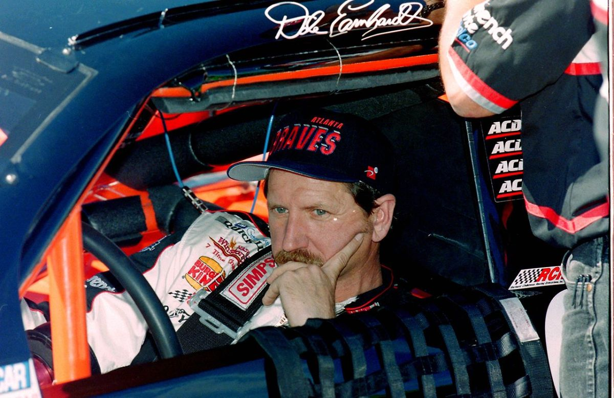 Dale Earnhardt sitting in his car.