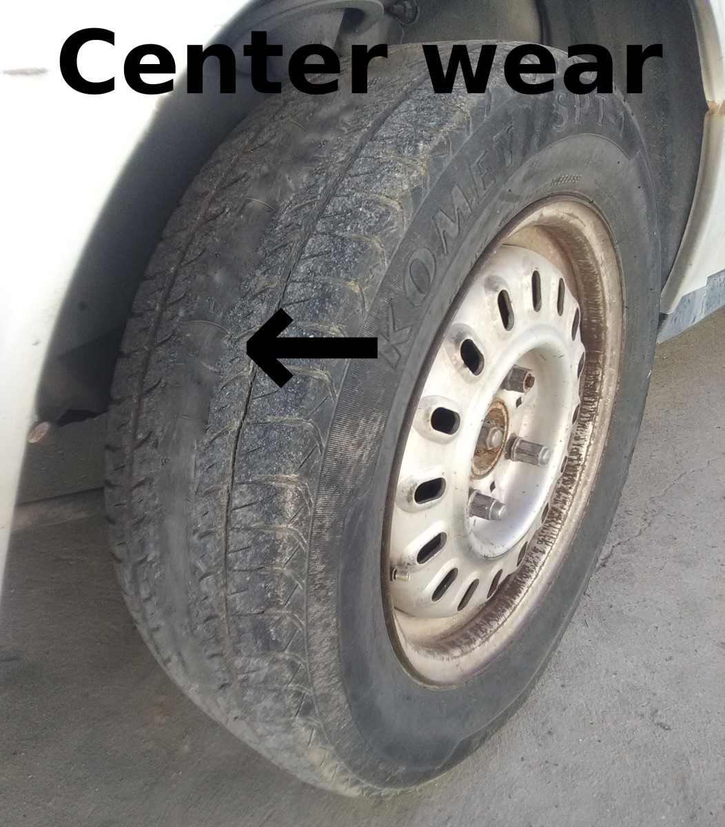 A car tire with a worn center tread is usually caused by overinflation pressure.