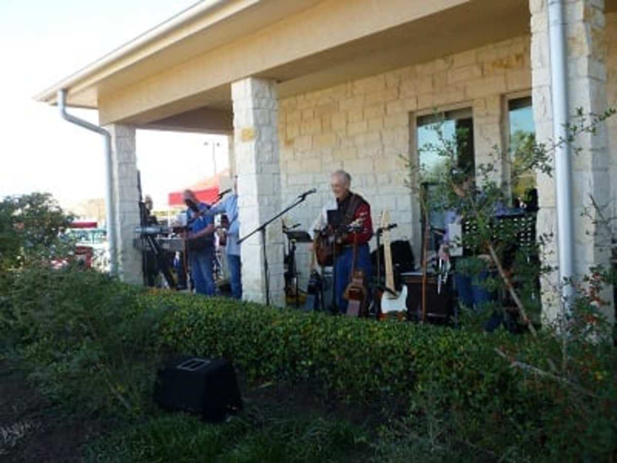 Band playing outdoors during car show at Towne Lake