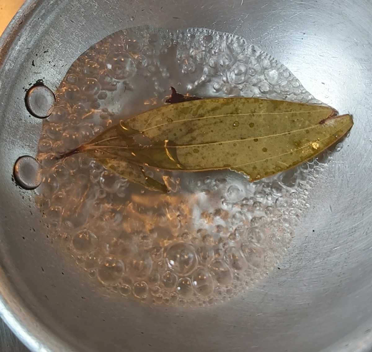 Add 1-2 bay leaves and 1-2 cloves. Keep the heat low.
