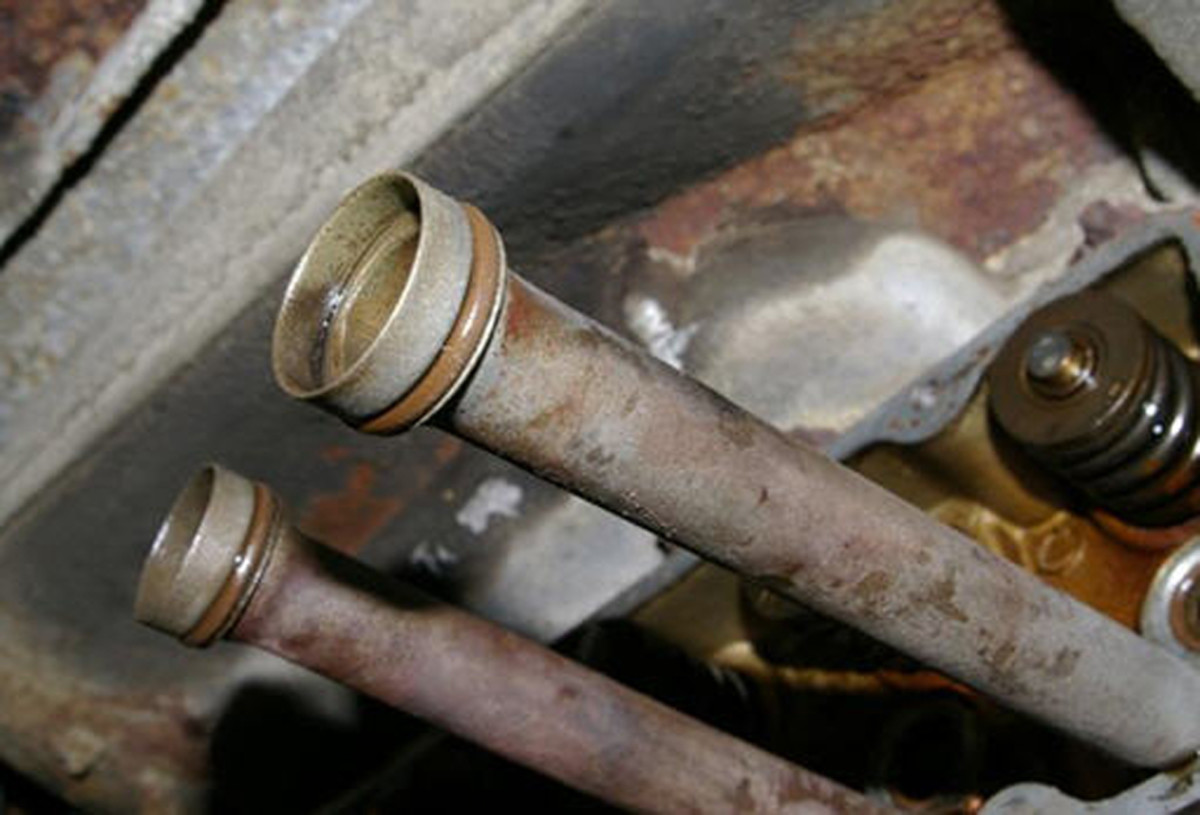 Pushrod Tubes. The red band is the O-ring that is replaced with Viton brand.