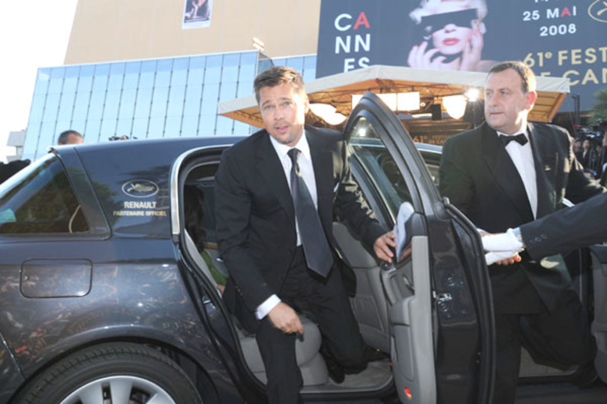 Brad Pitt at the Cannes Film Festival coming out of a Renault Vel Satis