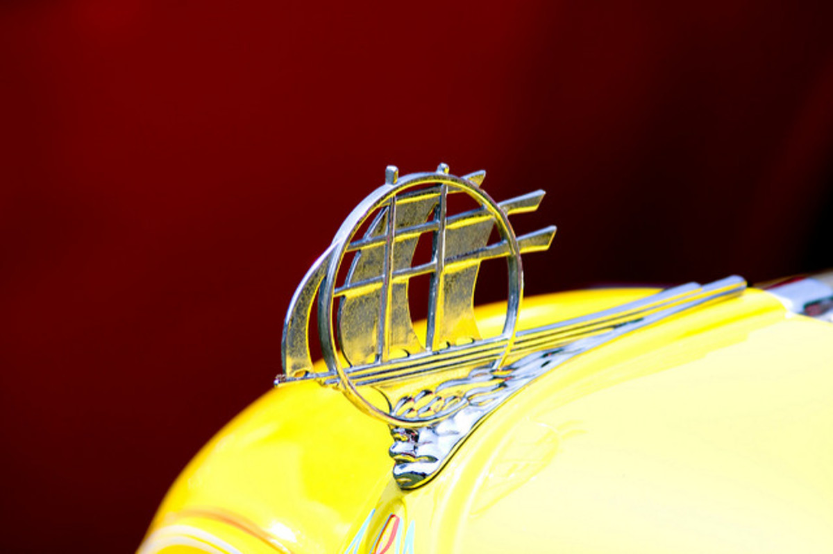 "Yellow Plymouth With ""Schooner"" Hood Ornament"