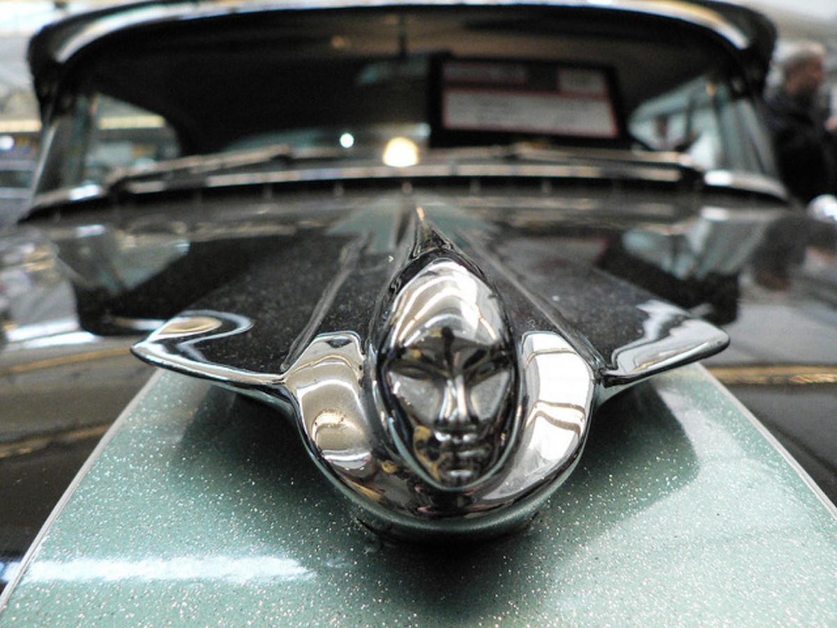 "A Stylized ""Woman/Rocket"" On A 1955 Cadillac"