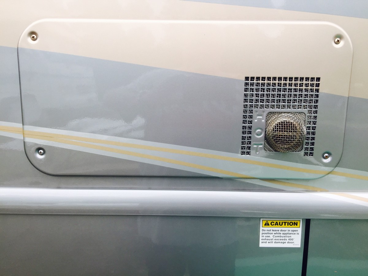 A standard-design exterior exhaust for the propane furnace of an RV.