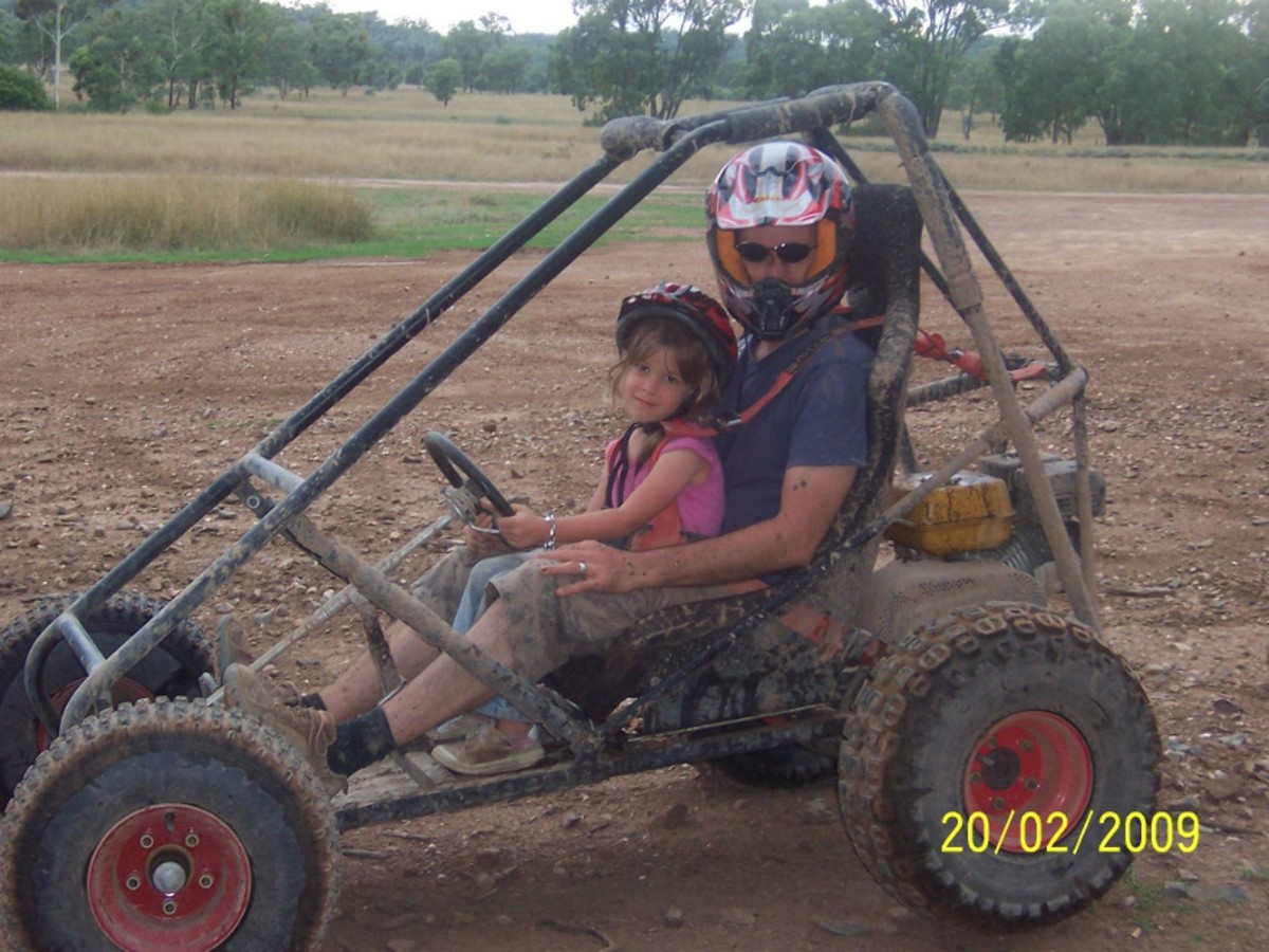 Taking a slow trip around the track with my youngest daughter, in the first buggy I built.