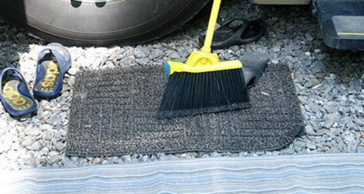Every camper should have a small mud rug to place at the bottom step of their RV door. By using one of these, there will be a lot less dirt, sand, and gravel tracked into the cabin. They only cost a couple of bucks and are worth every penny.