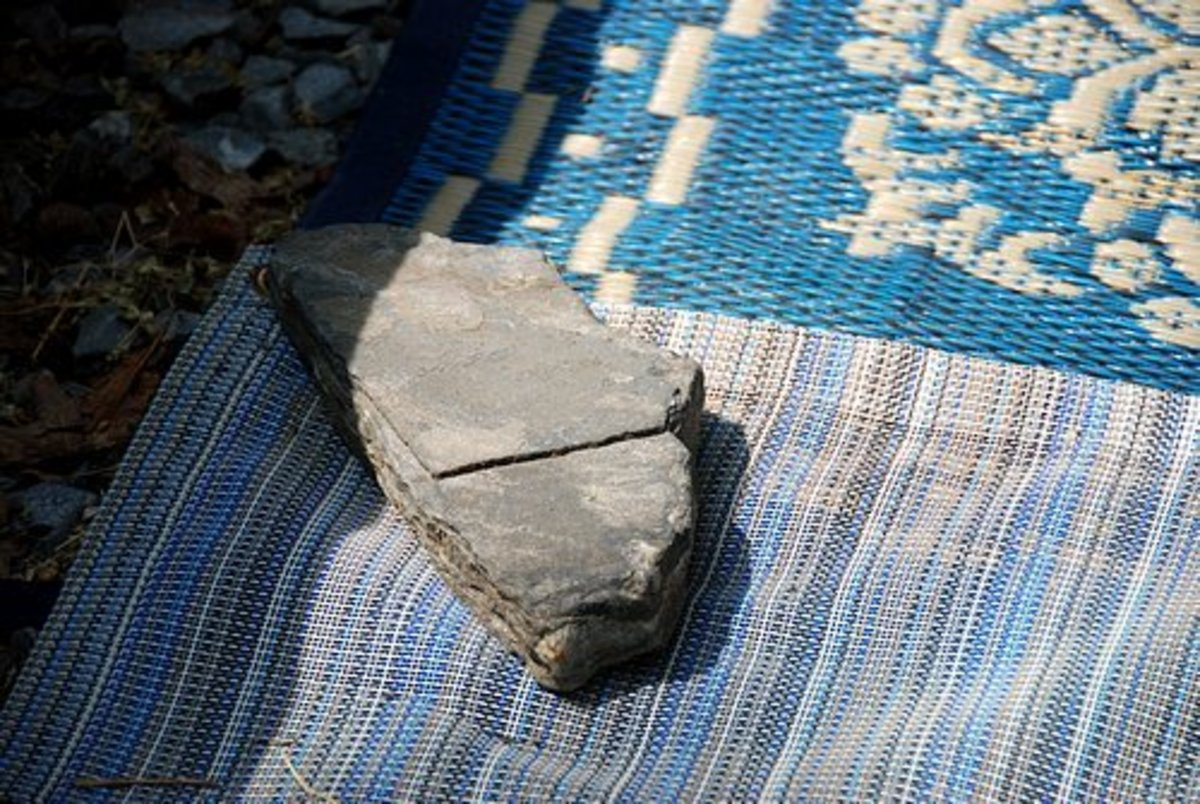 The inventive camper can always look around and find a rock to weigh down their rug.