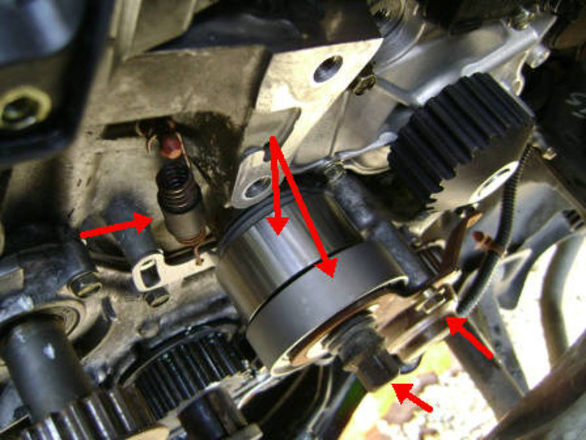 Install the new Timing Belt Idler Pulley and Tensioner Spring, Balance Shaft Pulley, Pulley Bracket and Bracket Bolt.