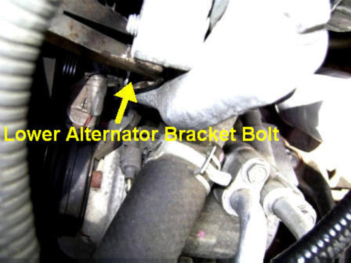 H.  Loosening the alternator bracket bolt