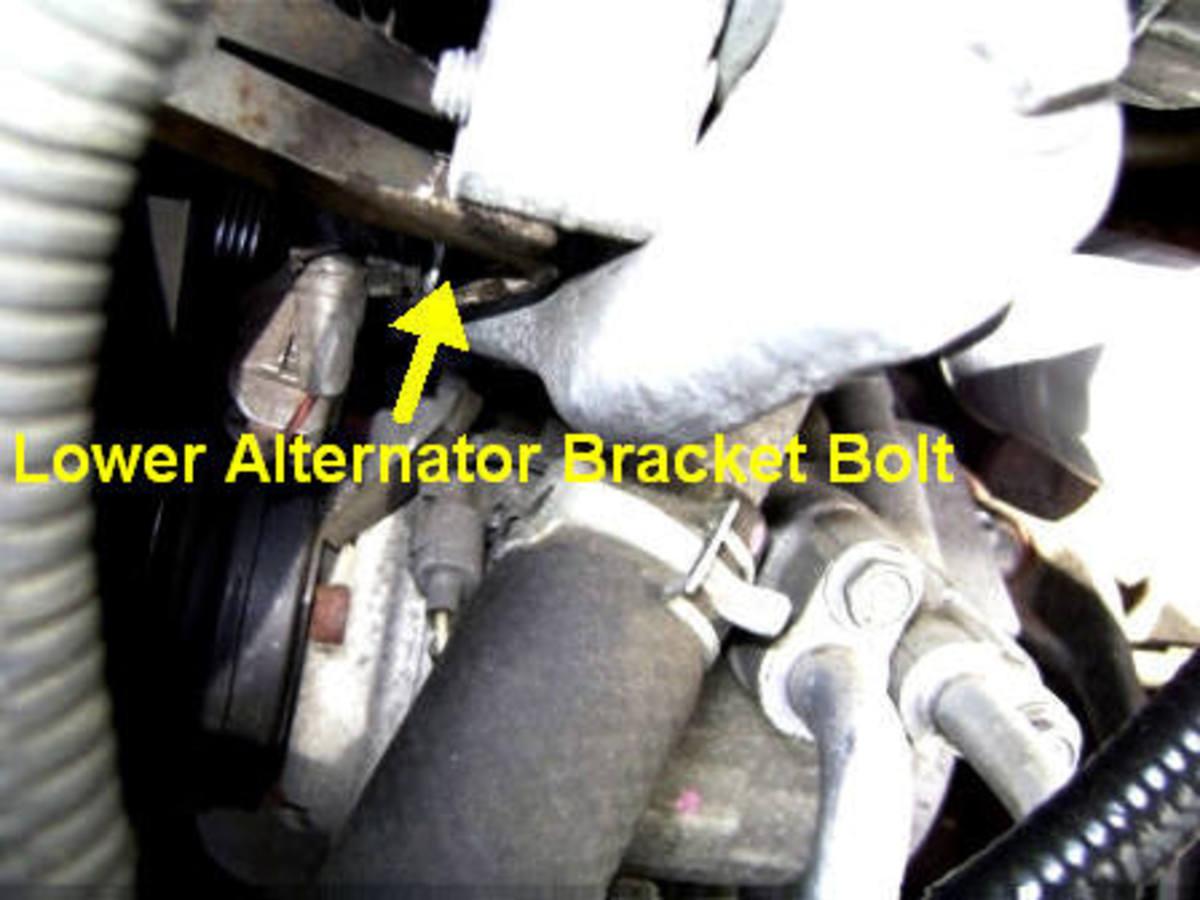 H.  Loosening the alternator bracket bolt