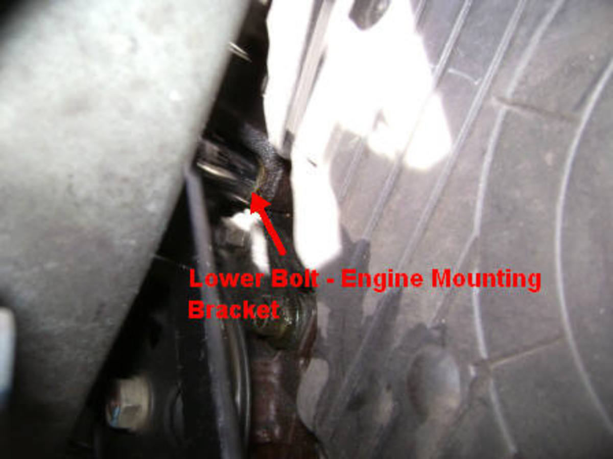 N.  Engine mounting bracket bolt removal