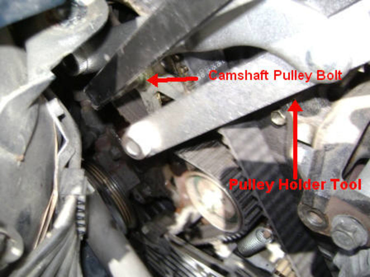 U. Removing the camshaft pulley bolt
