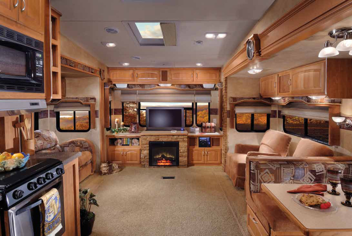 The interior of the 5th wheel above complete with double slide-outs and even a fireplace
