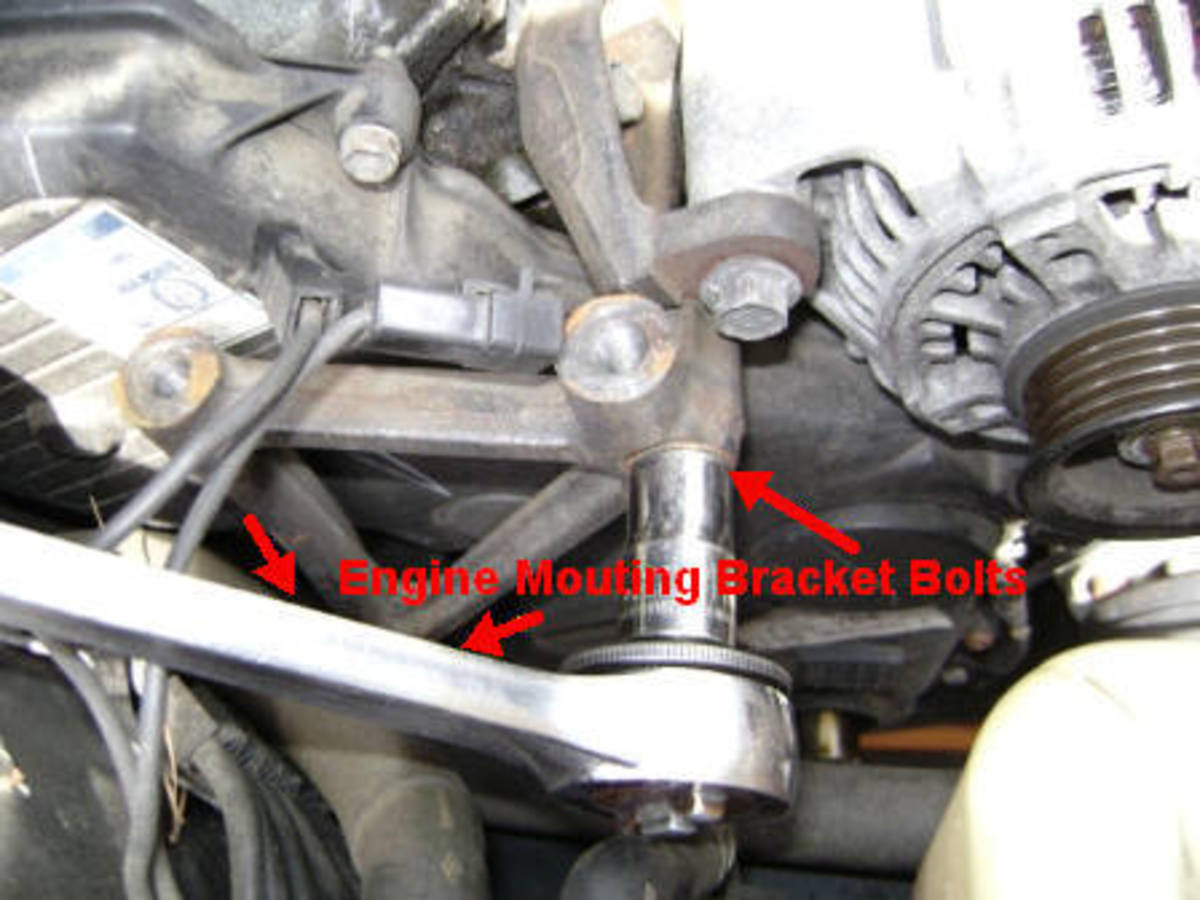 M. Engine mounting bracket bolt removal