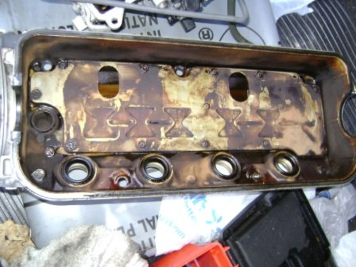 Valve Cover before new Spark Plug Gasket and Valve Cover