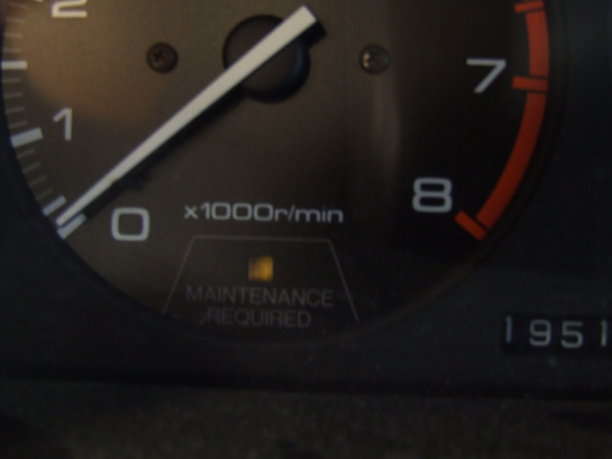 "This small yellow light (labeled ""maintenance indicator"") is not the ""check engine"" light (1991 Honda Accord)"