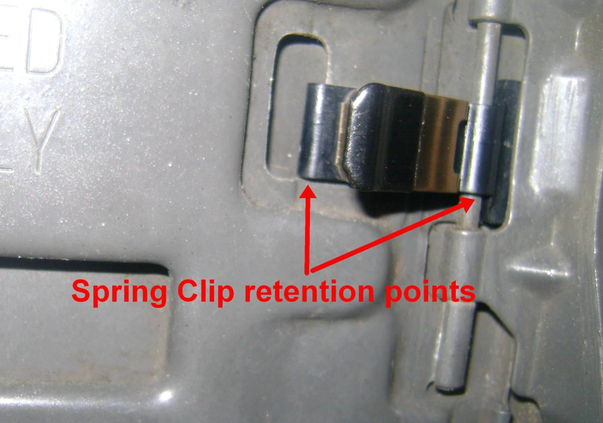 Toyota fuel door spring retention points