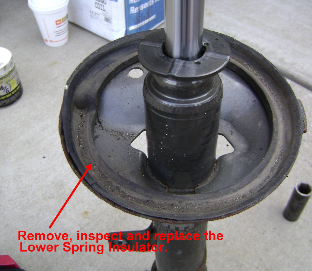Remove the Camry rear strut spring insulator