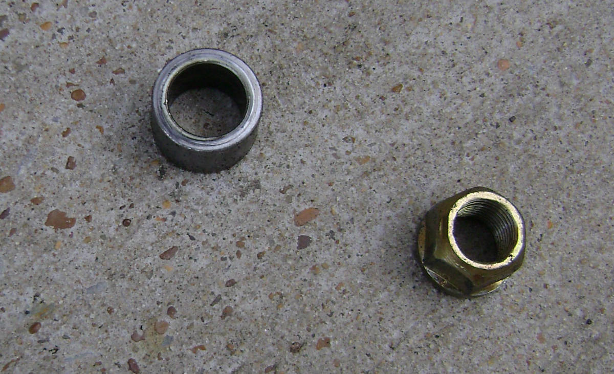 Camry upper strut mount nut and bushing removed