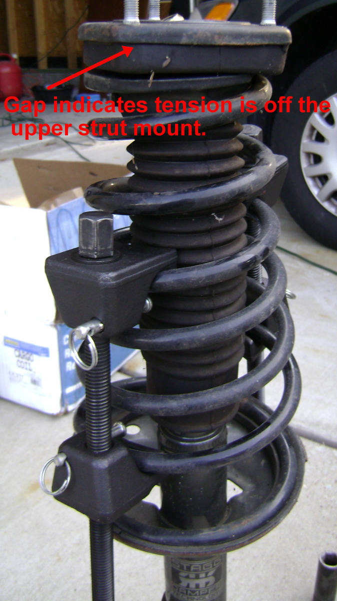 Compressed Camry rear strut springs
