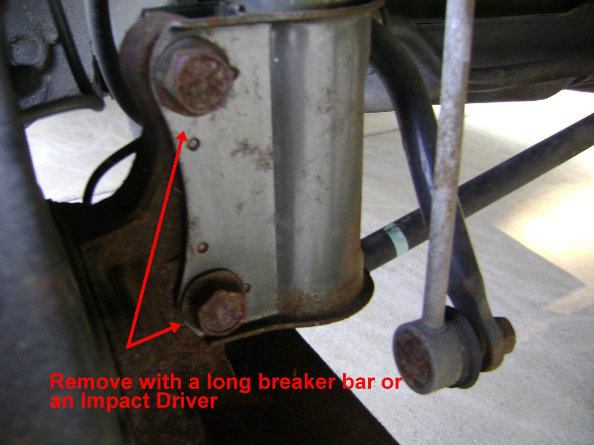 Removal of the lower strut assembly mounting nuts and bolts