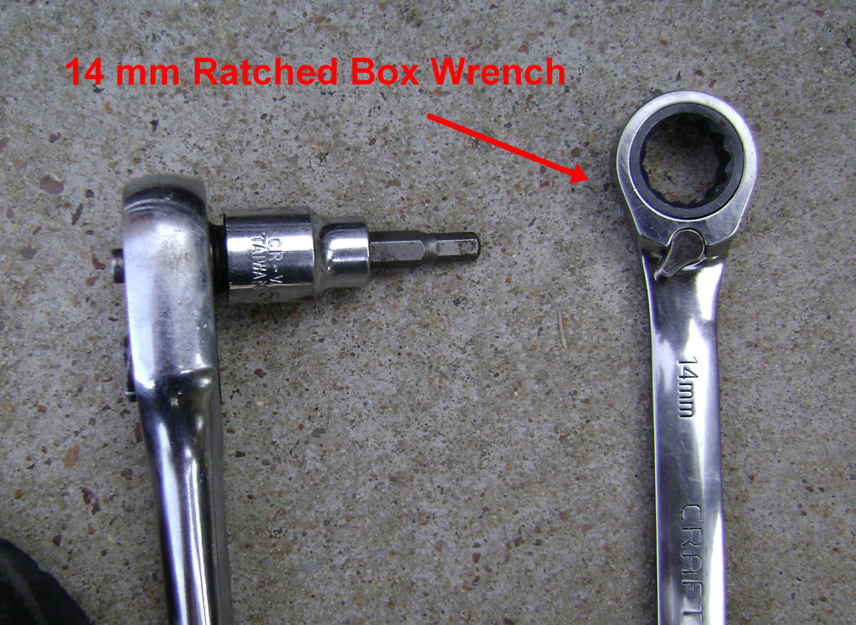 socket wrench attached to 5mm socket and a 14mm racheted box wrench