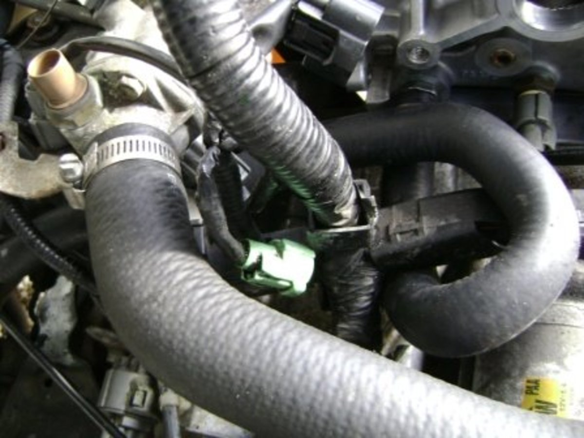 Alternate way to remove the lower hose: Detach the lower radiator hose from the thermostat housing.