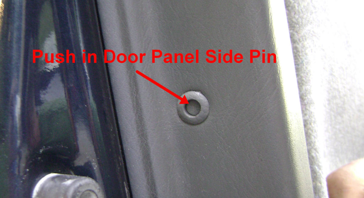 i(2). Push in the center door panel pin.