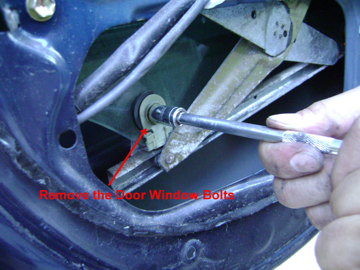 Remove the Door Window Mounting Bolts.