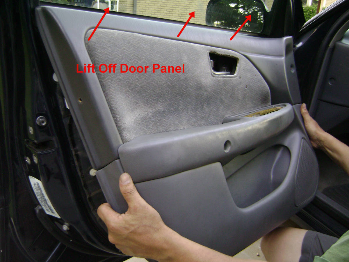 l. Pull out and up to remove the door panel.