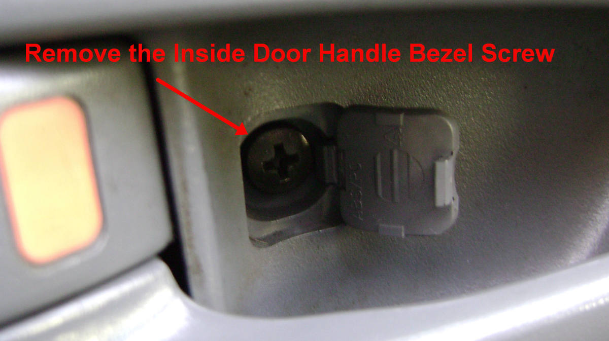 d.  Remove the inside door handle bezel screw.