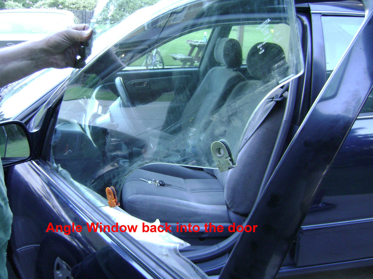 Angle the Door Window into the door.  A helper can then assist in positioning the Door Glass then screw on the Door Glass Mounting Bolts.