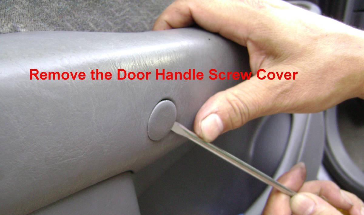 g. Remove the door handle cover