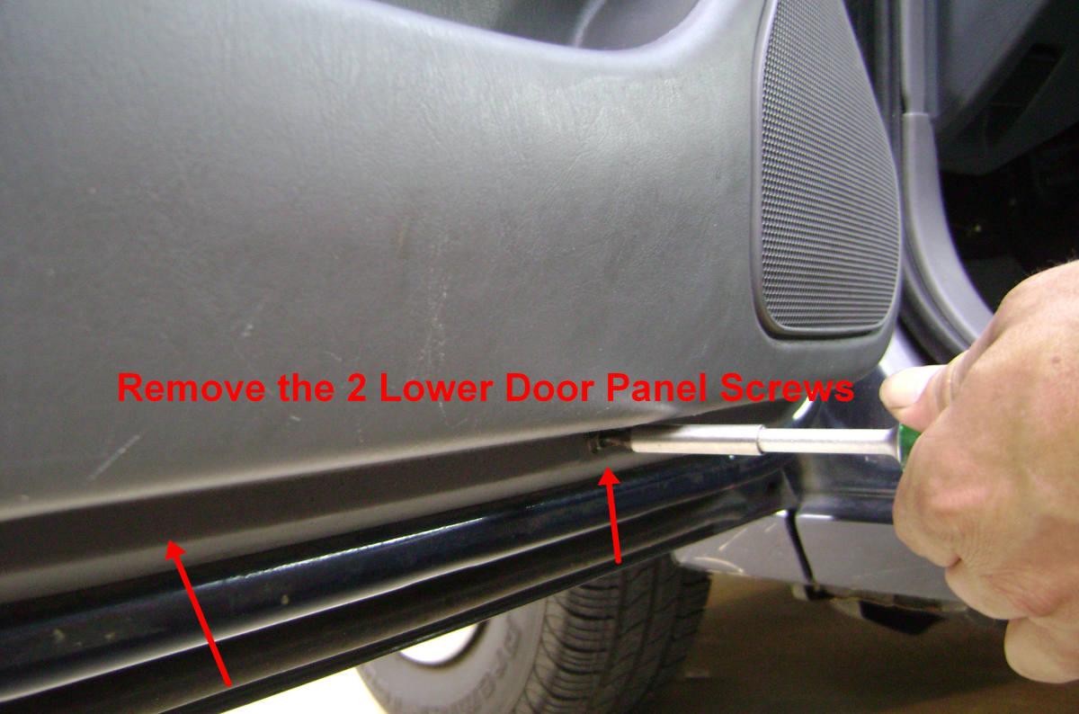 j. Remove the two bottom door panel screws.
