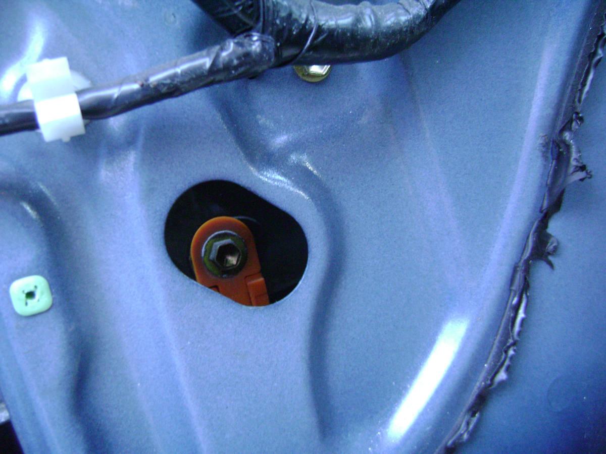b(2). Second door window mounting bolt.