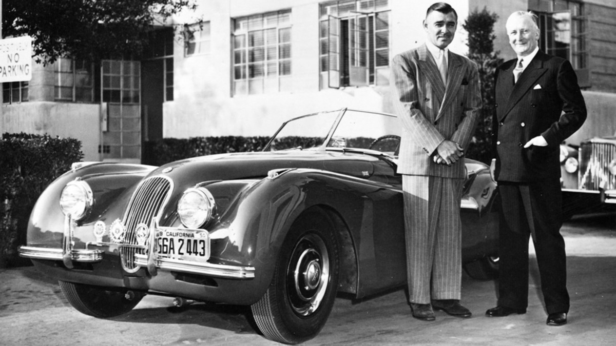"THE JAGUAR SPORTS CAR XK 120 WITH ITS PROUD OWNER, CLARK GABLE, AND ""MR JAGUAR"" SIR WILLIAM LYONS"