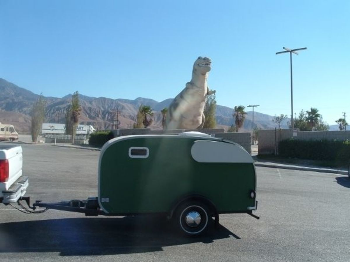 All of our trailers have had their photos taken with the dinosaur.