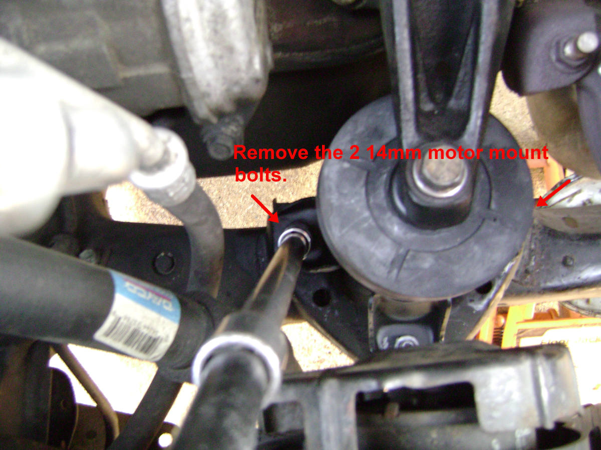 Remove the remaining lower motor mount bolts.