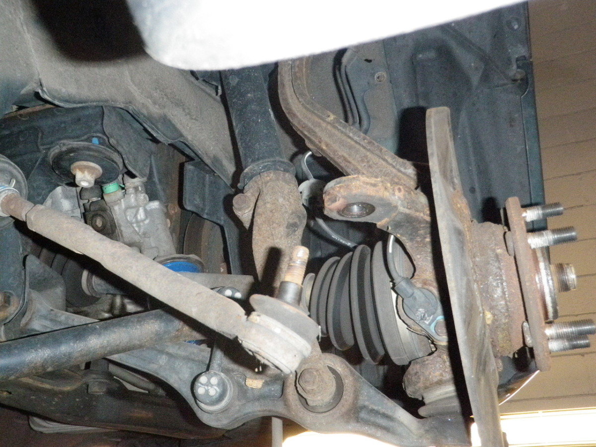 Disconnect the tie rod end, lower, and upper ball joints from the knuckle assembly.