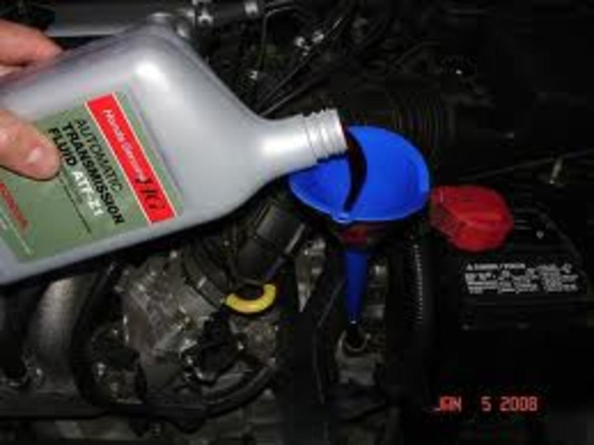 Typically you fill the transmission through the dipstick tube, using a small funnel.